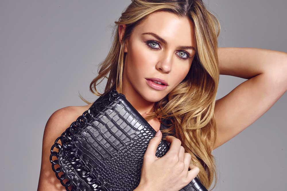 Abbey Clancy wears factor fifty Heliocare everywhere!